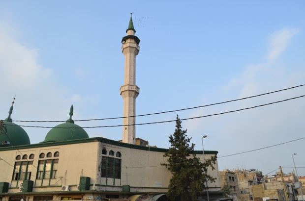 The mosque and its bullet holes.