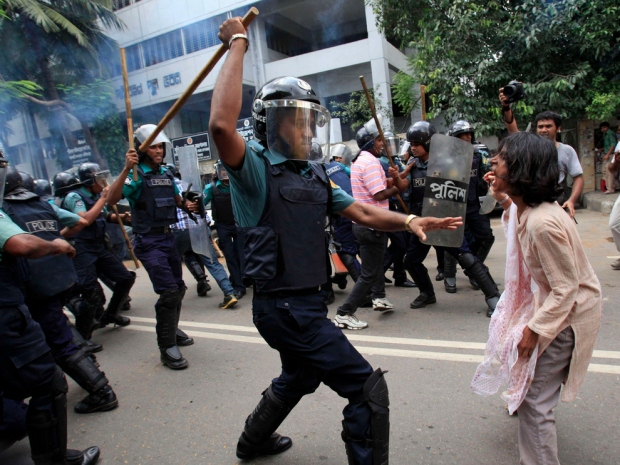 Bangladesh Riot Beating woman with baton