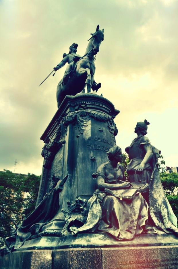 A statue next to Palais des Beaux Arts