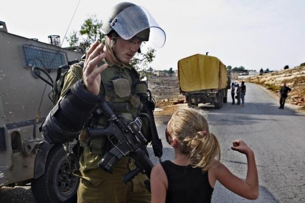 Palestinian girl punching Israeli soldier