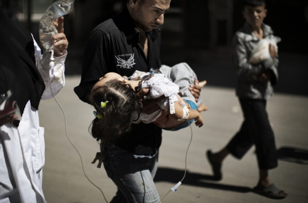 Syrian Father saving daughter hospital Aleppo