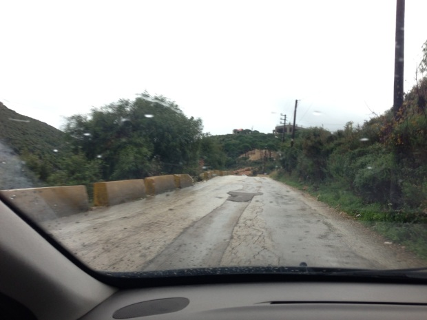 """The """"fixed"""" part of the road is a hole in itself as evident by the mini-stream flowing through it"""