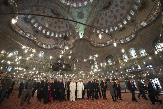 Pope Francis is shown the Sultan Ahmet mosque, popularly known as the Blue Mosque, by Mufti of Istanbul, Rahmi Yaran, during his visit to Istanbul